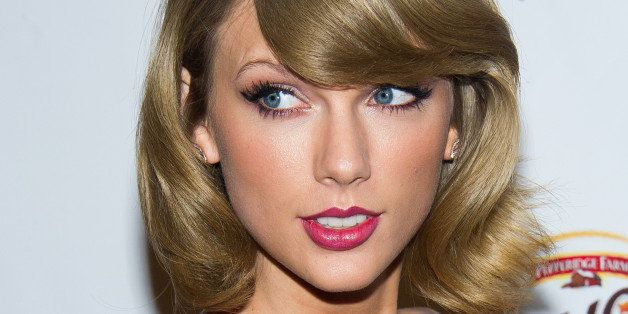 Taylor Swift poses in the Z100 Jingle Ball press room at Madison Square Garden on Friday, Dec. 12, 2014, in New York. (Photo