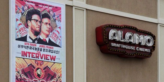 A large poster advertising the movie The Interview hangs on the back wall of the Alamo Drafthouse Cinema Tuesday, Dec. 23, 20