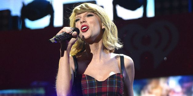 NEW YORK, NY - DECEMBER 12:  Taylor Swift performs onstage during iHeartRadio Jingle Ball 2014, hosted by Z100 New York and p