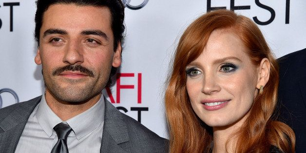 HOLLYWOOD, CA - NOVEMBER 06:  Actors Oscar Isaac (L) and Jessica Chastain attend AFI FEST 2014 presented by Audi opening nigh