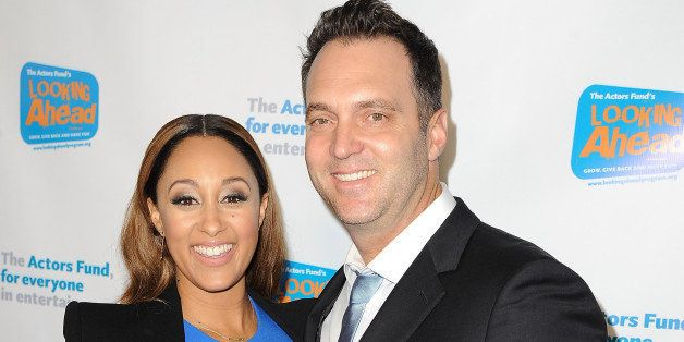 HOLLYWOOD, CA - DECEMBER 04: Actress Tamera Mowry and journalist Adam Housley arrive at The Actor's Fund 2014 The Looking Ahead Awards at Taglyan Cultural Complex on December 4, 2014 in Hollywood, California. (Photo by Angela Weiss/Getty Images)