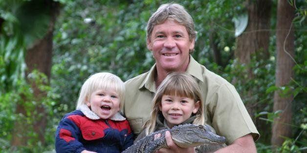 SUNSHINE COAST, AUSTRALIA - JUNE 25:  (EUROPE AND AUSTRALASIA OUT) Bob, Steve and Bindi Irwin pose with 3yr old alligator Rus