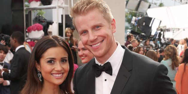 Catherine Giudici, left, and Sean Lowe arrive at the 66th Primetime Emmy Awards at the Nokia Theatre L.A. Live on Monday, Aug