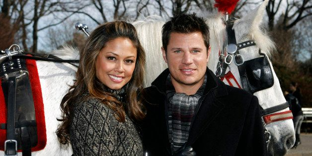 Vanessa Minnillo and Nick Lachey pose together with a carriage horse during a promotional event for Nivea in New York's Centr