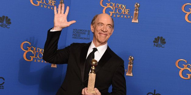 J.K. Simmons poses in the press room with the award for best supporting actor in a motion picture - drama, musical or comedy