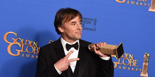 """Richard Linklater poses in the press room with the award for best director for """"Boyhood"""" at the 72nd annual Golden Globe"""