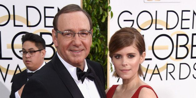 BEVERLY HILLS, CA - JANUARY 11:  Actors Kevin Spacey (L) and Kate Mara attend the 72nd Annual Golden Globe Awards at The Beve