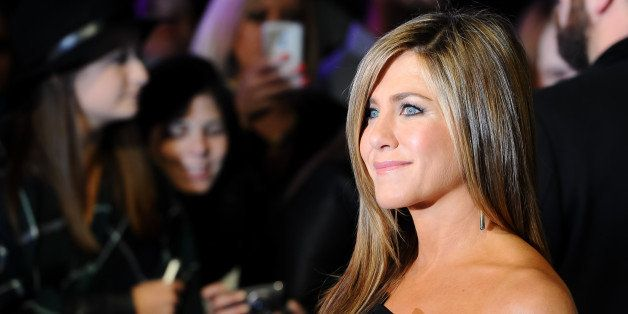 Actress Jennifer Aniston poses for photographers at the World Premiere of Horrible Bosses 2 at a central London cinema, Londo