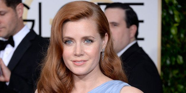 BEVERLY HILLS, CA - JANUARY 11:  72nd ANNUAL GOLDEN GLOBE AWARDS -- Pictured: Actress Amy Adams arrives to the 72nd Annual Go