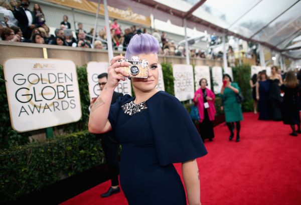 LOS ANGELES, CA - JANUARY 11: 72nd ANNUAL GOLDEN GLOBE AWARDS -- Pictured: TV personality Kelly Osbourne arrives to the 72nd