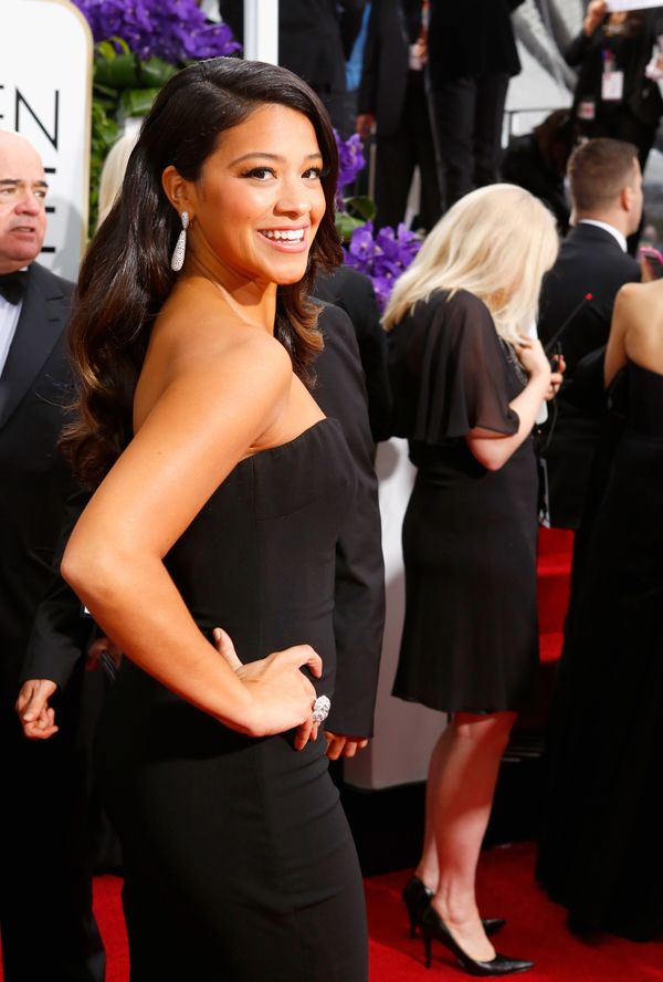 LOS ANGELES, CA - JANUARY 11: 72nd ANNUAL GOLDEN GLOBE AWARDS -- Pictured: Actress Gina Rodriguez arrives to the 72nd Annual