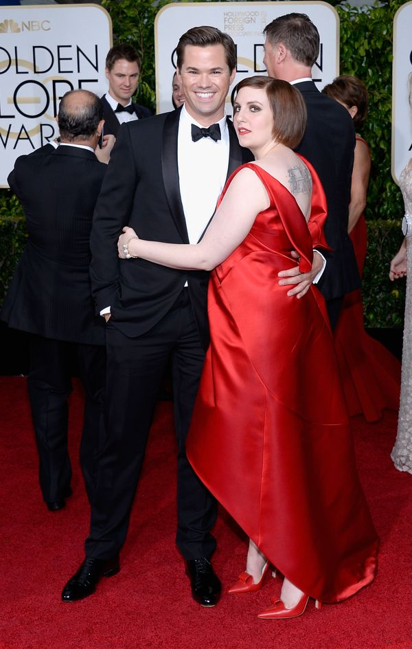 BEVERLY HILLS, CA - JANUARY 11:  72nd ANNUAL GOLDEN GLOBE AWARDS -- Pictured: (l-r) Actors Andrew Rannells and Lena Dunham ar