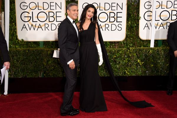 BEVERLY HILLS, CA - JANUARY 11:  Actor George Clooney (L) and Amal Clooney attend the 72nd Annual Golden Globe Awards at The