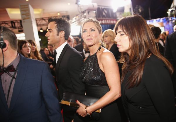 LOS ANGELES, CA - JANUARY 11: 72nd ANNUAL GOLDEN GLOBE AWARDS -- Pictured: (l-r) Actors Justin Theroux and Jennifer Aniston a