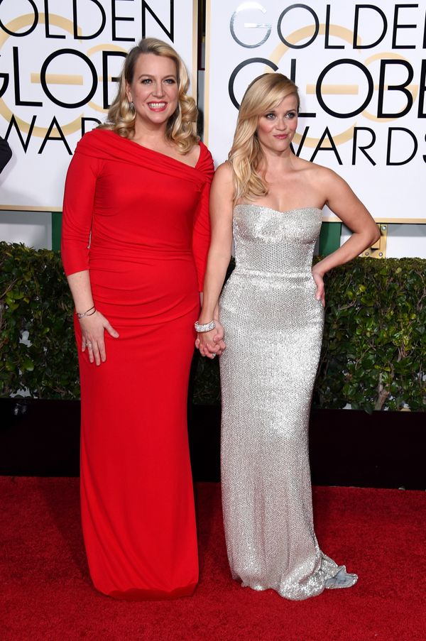 BEVERLY HILLS, CA - JANUARY 11:  Writer Cheryl Strayed (L) and actress Reese Witherspoon attend the 72nd Annual Golden Globe