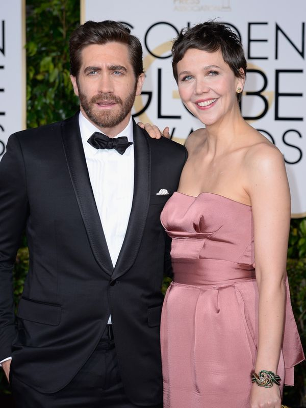 BEVERLY HILLS, CA - JANUARY 11:  72nd ANNUAL GOLDEN GLOBE AWARDS -- Pictured: (l-r) Actors Jake Gyllenhaal and Maggie Gyllenh