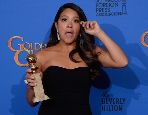 BEVERLY HILLS, CA - JANUARY 11:  72nd ANNUAL GOLDEN GLOBE AWARDS -- Pictured: Gina Rodriguez poses in the press room at the 7