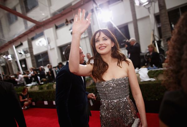 LOS ANGELES, CA - JANUARY 11: 72nd ANNUAL GOLDEN GLOBE AWARDS -- Pictured: Actress Dakota Johnson arrives to the 72nd Annual