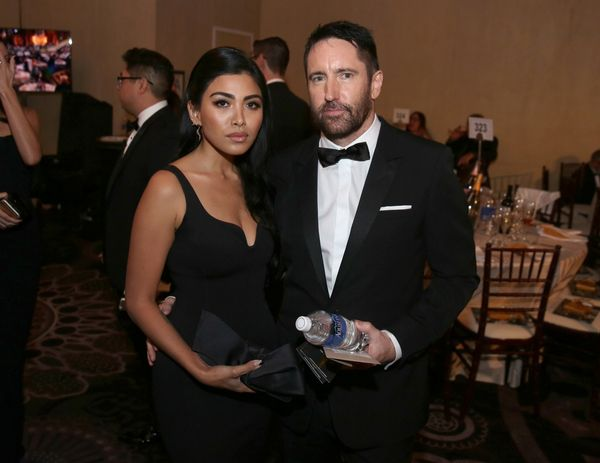 Mariqueen Maandig, left, and Trent Reznor pose in the audience at the 72nd annual Golden Globe Awards at the Beverly Hilton H