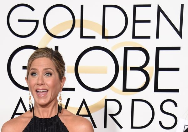 Actress Jennifer Aniston arrives on the red carpet for the 72nd annual Golden Globe Awards, January 11, 2015 at the Beverly H