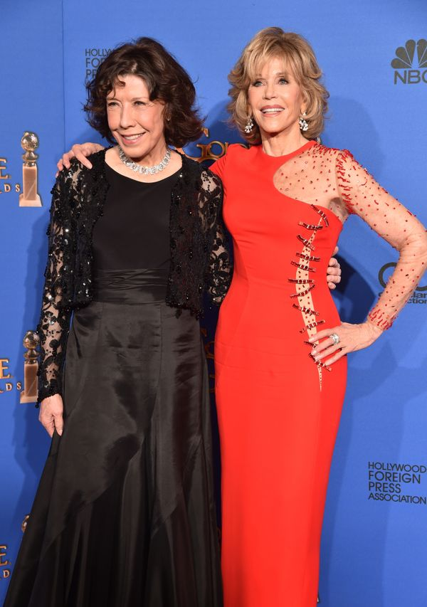 BEVERLY HILLS, CA - JANUARY 11:  Actresses Lily Tomlin (L) and Jane Fonda pose in the press room during the 72nd Annual Golde