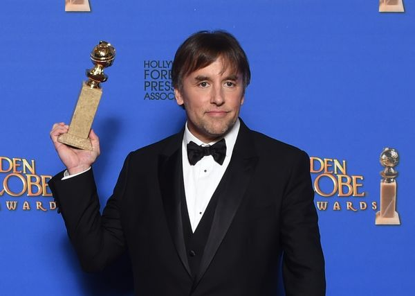Director Richard Linklater poses with the award for Best Director - Motion Picture for 'Boyhood,' in the press room at the 72