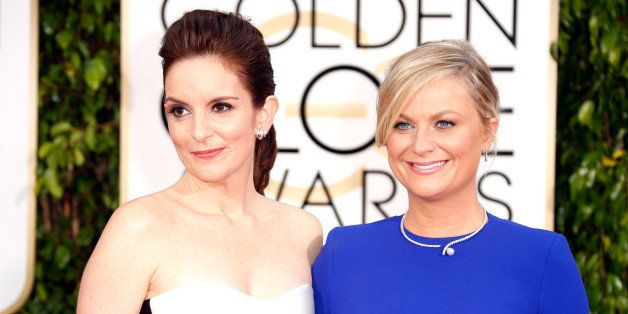 BEVERLY HILLS, CA - JANUARY 11:  Hosts Tina Fey (L) and Amy Poehler attend the 72nd Annual Golden Globe Awards at The Beverly