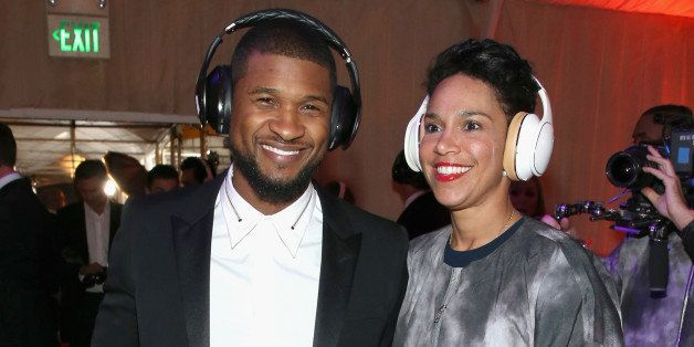 LOS ANGELES, CA - JANUARY 10: Recording artist Usher (L) and Grace Miguel, wearing Samsung Level headphones, attend the 8th A