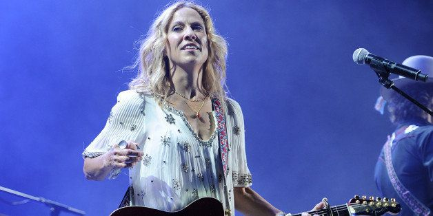 Sheryl Crow performs during the Rewind Tour at the Cruzan Amphitheater on September 13, 2014 in West Palm  Beach, Florida. (P