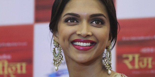 In this Wednesday, Oct. 9, 2013 photo, Indian Bollywood actress Deepika Padukone smiles during a press conference held to pro