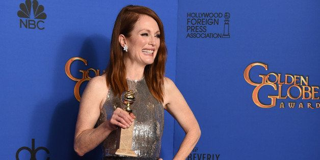 "Julianne Moore poses in the press room with the award for best actress in a motion picture - drama for ""Still Alice"" at t"