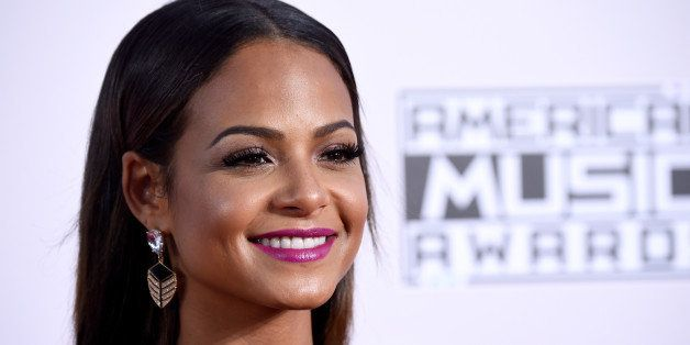 LOS ANGELES, CA - NOVEMBER 23:  Actress Christina Milian attends the 2014 American Music Awards at Nokia Theatre L.A. Live on