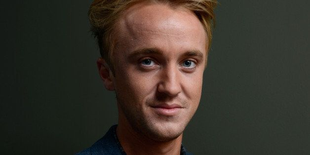 TORONTO, ON - SEPTEMBER 07:  Actor Tom Felton of 'Therese' poses at the Guess Portrait Studio during 2013 Toronto Internation
