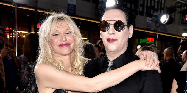 LOS ANGELES, CA - SEPTEMBER 06:  Singers Courtney Love and Marilyn Manson arrive at the season 7 premiere screening of FX's '