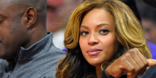 Singer Beyonce watches the first half of an NBA basketball game between the Los Angeles Clippers and the Brooklyn Nets, Thurs