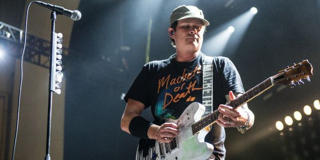 LONDON, UNITED KINGDOM - AUGUST 06: Thomas DeLonge of Blink 182 performs on stage during their Reading Leeds Festival warmup