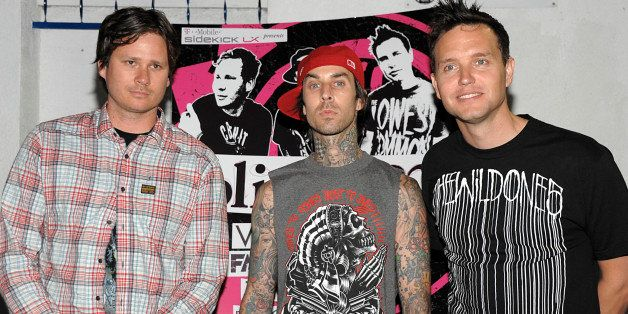 FILE - In this May 18, 2009 file photo, Tom DeLonge, left, drummer Travis Barker, and singer and musician Mark Hoppus, right,