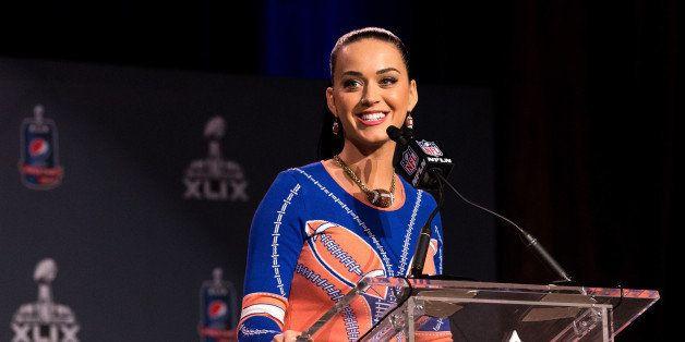 PHOENIX, AZ - JANUARY 29:  Recording artist Katy Perry speaks onstage at the Pepsi Super Bowl XLIX Halftime Show Press Confer