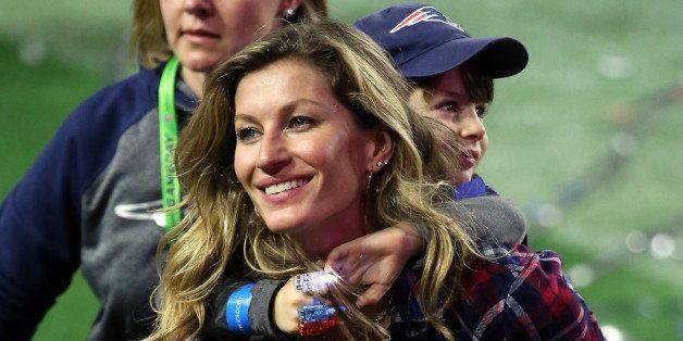GLENDALE, AZ - FEBRUARY 01:  Gisele Bundchen, wife of  Tom Brady #12 of the New England Patriots, walks on the field with the
