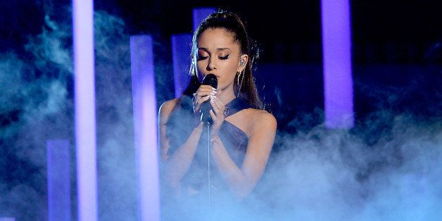 LOS ANGELES, CA - FEBRUARY 08:  Singer Ariana Grande performs 'Just a Little Bit of Your Heart' onstage during The 57th Annua
