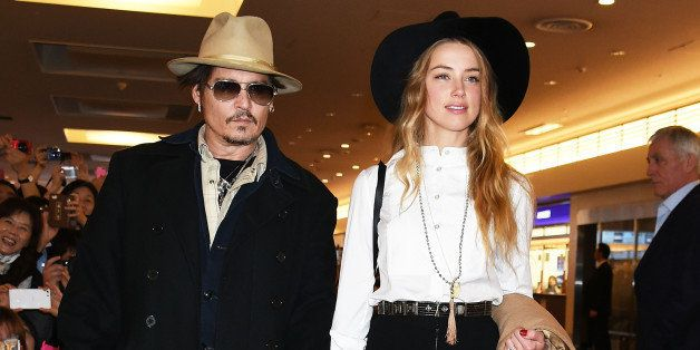 TOKYO, JAPAN - JANUARY 26:  Johnny Depp and Amber Heard are seen upon arrival at Haneda Airport on January 26, 2015 in Tokyo,