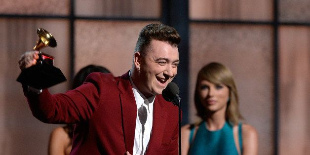 LOS ANGELES, CA - FEBRUARY 08:  Singer Sam Smith (L) accepts the Best New Artist award from singer Taylor Swfit onstage durin