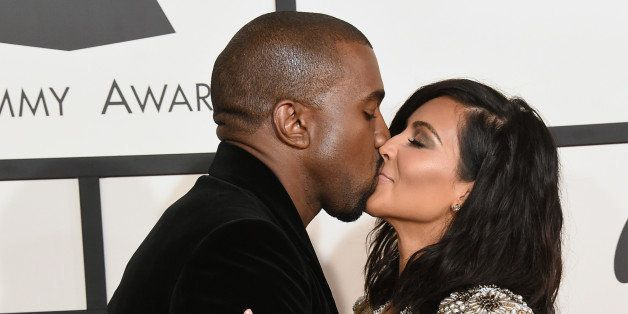 LOS ANGELES, CA - FEBRUARY 08:  Recording artist Kanye West (L) and TV personality Kim Kardashian attend The 57th Annual GRAM