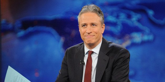 "FILE - This Nov. 30, 2011 file photo shows television host Jon Stewart during a taping of ""The Daily Show with Jon Stewart"" i"