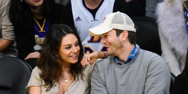 LOS ANGELES, CA - DECEMBER 19:  Mila Kunis (L) and Ashton Kutcher attend a basketball game between the Oklahoma City Thunder
