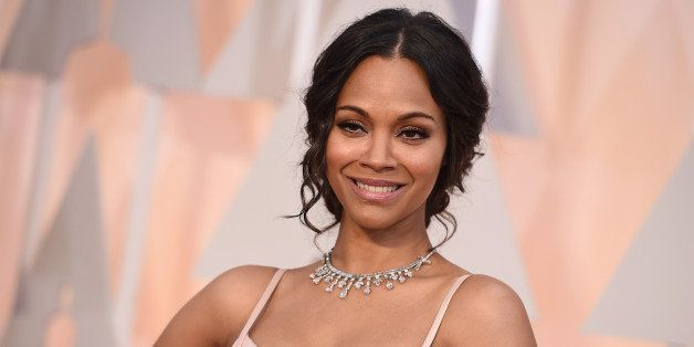 Zoe Saldana arrives at the Oscars on Sunday, Feb. 22, 2015, at the Dolby Theatre in Los Angeles. (Photo by Jordan Strauss/Inv