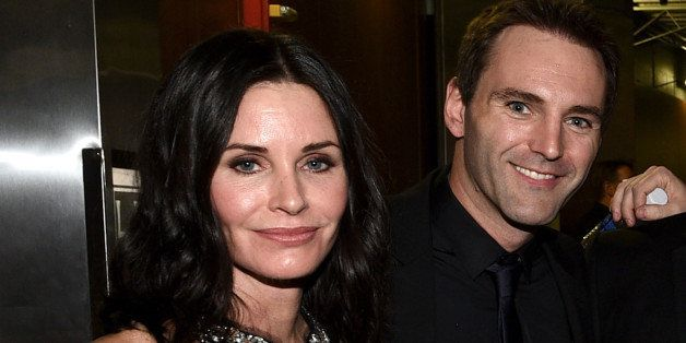 LOS ANGELES, CA - FEBRUARY 08: Actress Courteney Cox (L) and musician Johnny McDaid attend The 57th Annual GRAMMY Awards at S