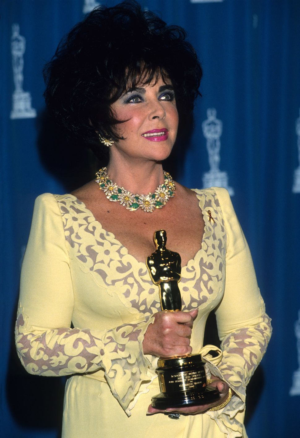 Elizabeth Taylor poses at the 65th annual Academy Awards in 1993.