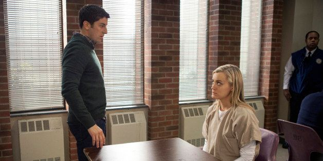 "This image released by Netflix shows Jason Biggs, left, and Taylor Schilling in a scene from ""Orange is the New Black."" T"