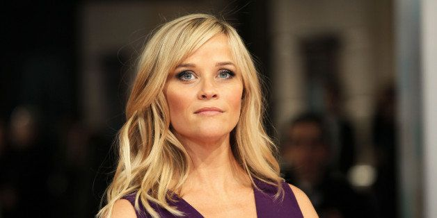 Actor Reese Witherspoon poses for photographers on arrival at the EE British Academy Film Awards in central London on Sunday,